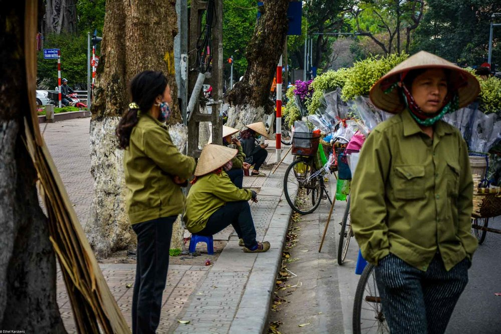 Women selling flowers in the street of Hanoi