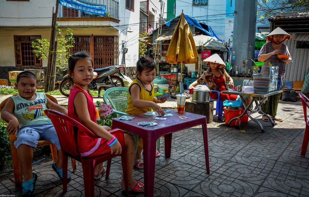 Girl playing cards (District eight, Saigon)