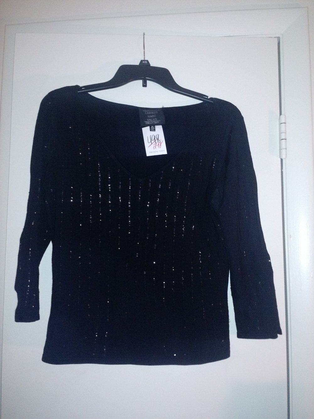 This is a simple black 3/4 sleeve shirt. Sequins done right! A shirt like this is perfect for Christmas and the holidays