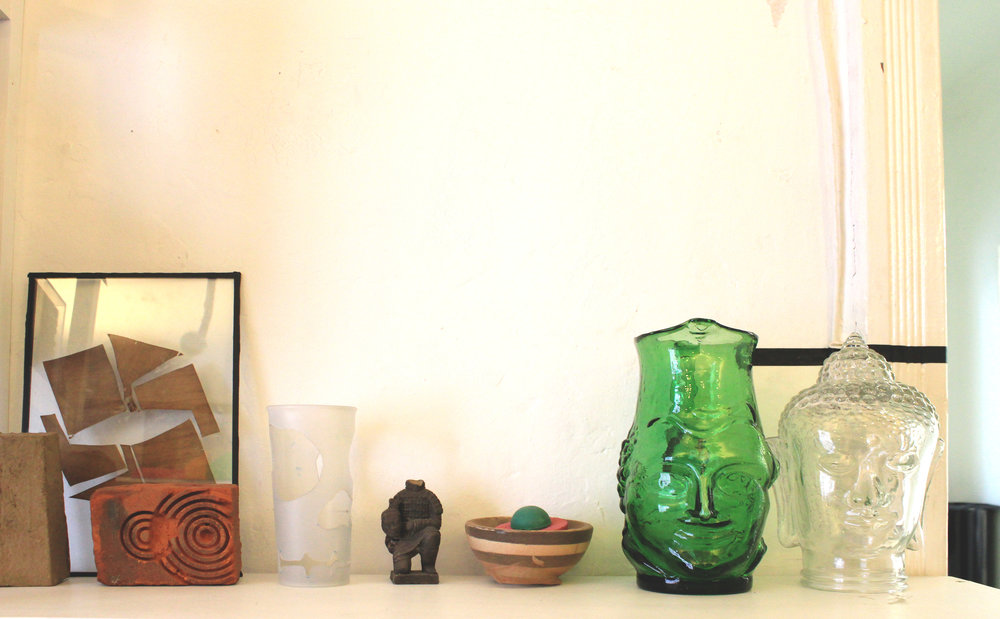 Collection of objects, jar, cut clay brick