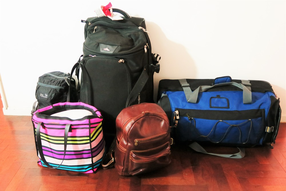 Our lives packed into a suitcase and backpack each!