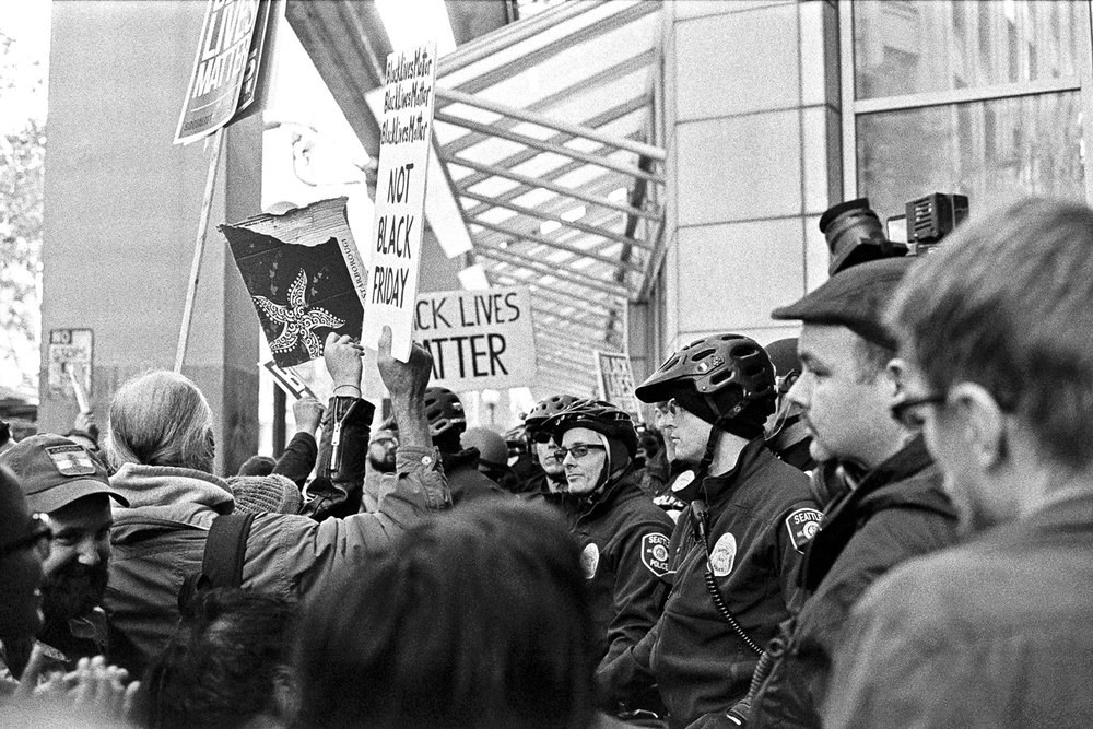 Protesters and police clash when trying to enter Westlake Center Mall. Black Lives Matter Protest, November 2015. Photography by Anthony Allison