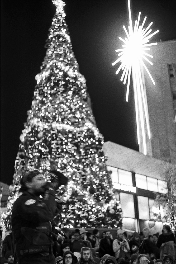 The annual Christmas Tree is lit under a sit-in protest at Westlake Center. Black Lives Matter Protest, November 2015. Photography by Anthony Allison