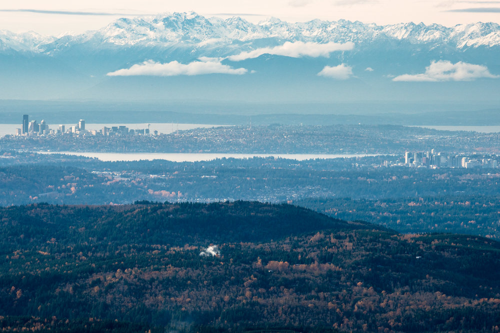 A view of Seattle and Bellvue skylines from the top of Mt. Si.