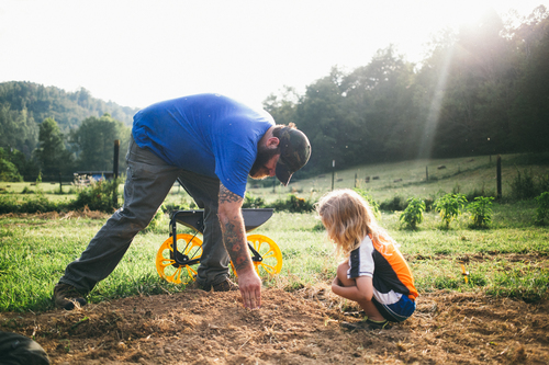 Harvesting_Liberty_Donnie-Hedden-36-Michael-Lewis-with-his-son-Roscoe-he-plants-roots-once-again-with-a-renewed-sense-of-purpose-and-pride.jpg