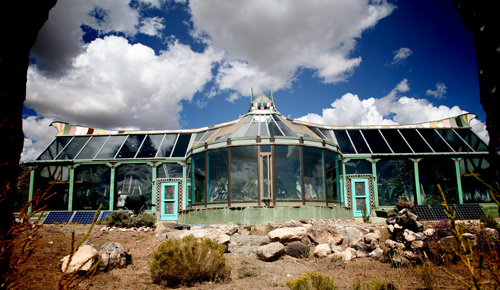 Exterior of The Phoenix - one of the larger Earthships in Taos, NM. The Phoenix can produce enough food for a family of four!