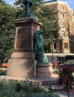 Wearing a bear, as one does, in Finland. JL Runeberg statue
