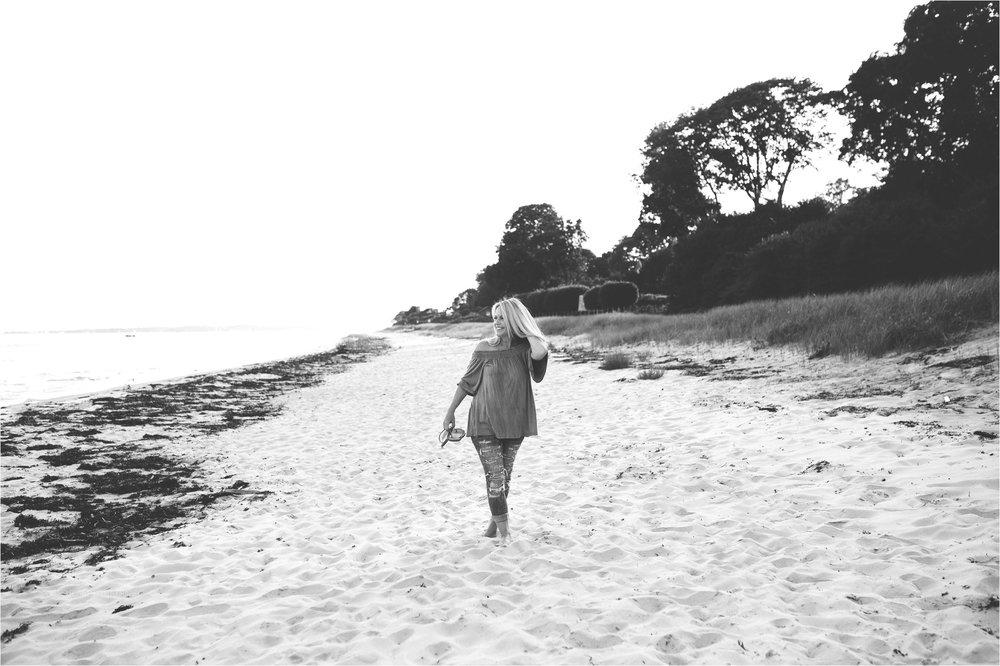 women walking along the beach