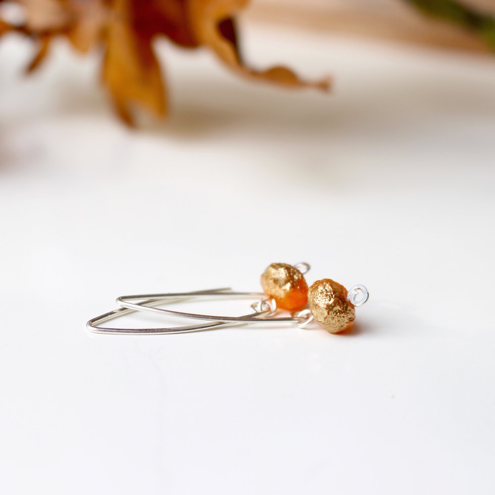 Rich burnt orange glass drops earrings with gold wash. Sterling silver. By Nina Parker