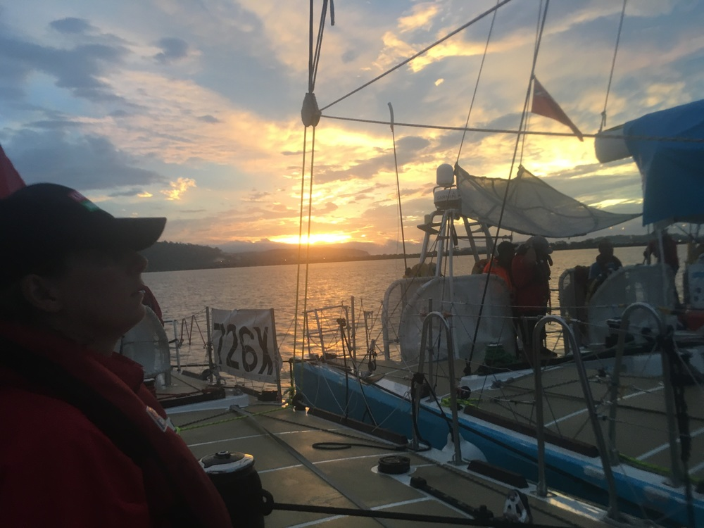 We were treated to a lovely sunset as we waited 3.5 hours, rafted together on a morning can in the lake, for a new pilot to join us after the first's shift was over.