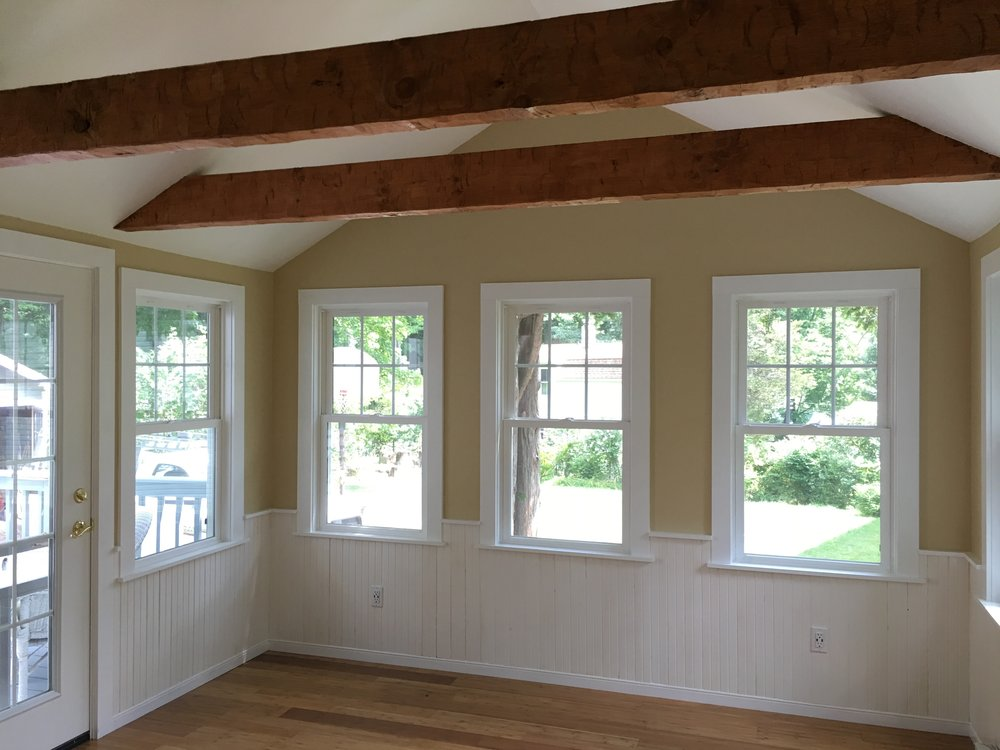 sunroom with hand hewn beams