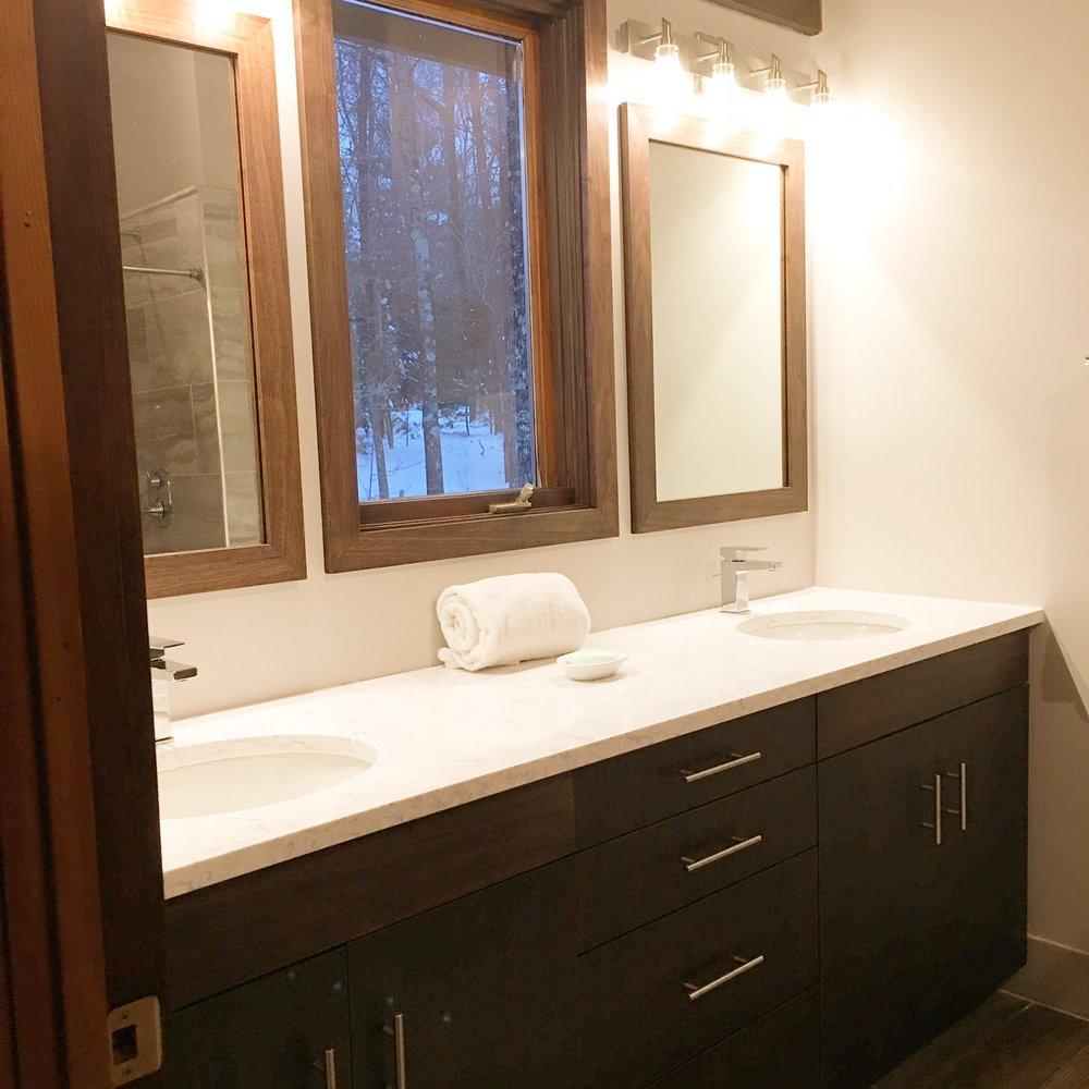 Walnut vanity with custom mirrors