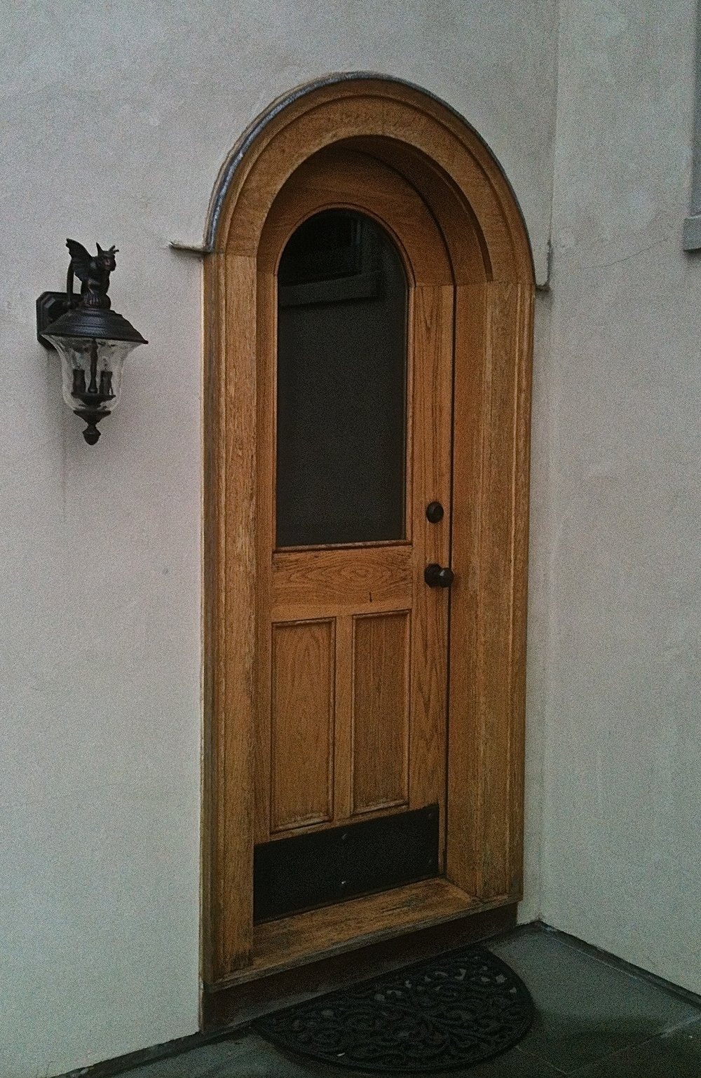 Round top with glass entry door