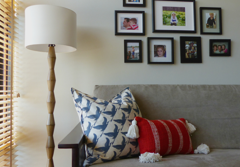 Floor lamp - Target ;  Bird pillow - Pottery Barn ; Tassel pillow - West Elm (discontinued); Futon cover - Right-On Futon; Frames - Ikea