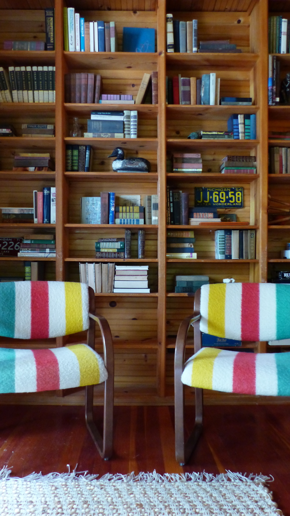 Styled bookshelves for miles! Hudson Bay chairs we found at Brimfield Chicago.