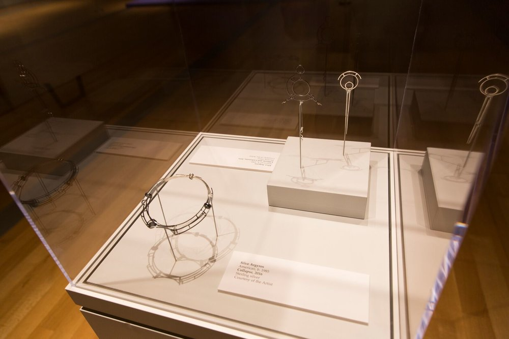"Display case at the GRAM with ""Collapse"" and ""Lithium Carbonate"""