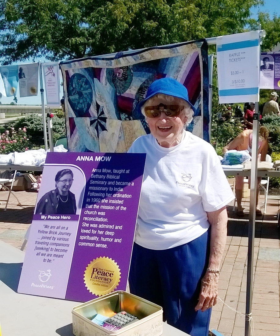 Charlotte with her Peace Hero, Anna Mow, at the September 11th Peace Heroes Walk in downtown Dayton. Her new quilt, Imperfect World, hangs behind her.