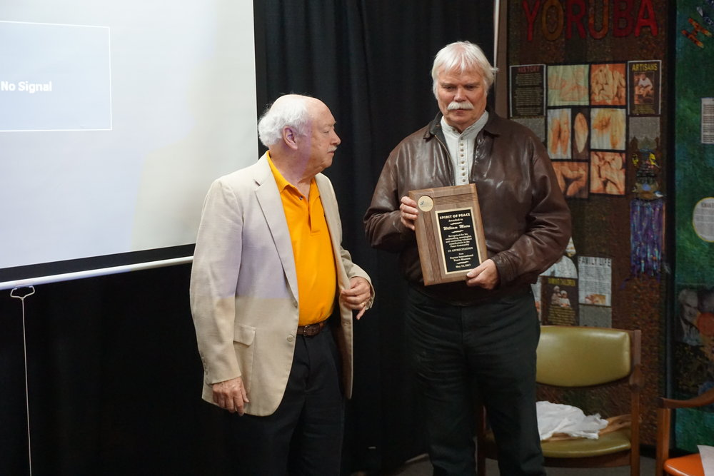 Executive Director, Michael Kalter presents long-time peace museum volunteer and leadership team member Bill Meers with a special award of recognition at Saturday's volunteer breakfast.