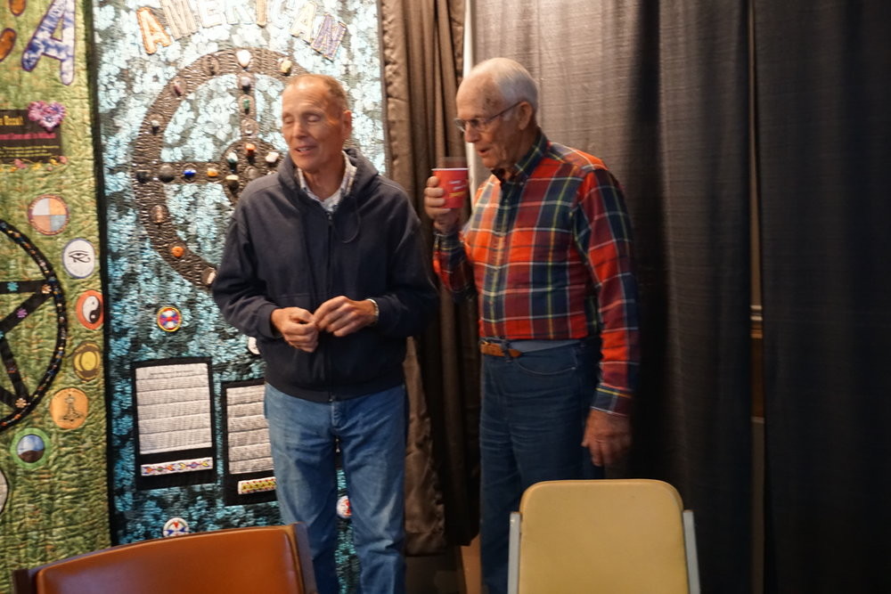 Veteran peace activists Tim Lingg and co-founder of the museum, Ralph Dull, at the recent volunteer fair and breakfast celebration in Holbrooke Hall.