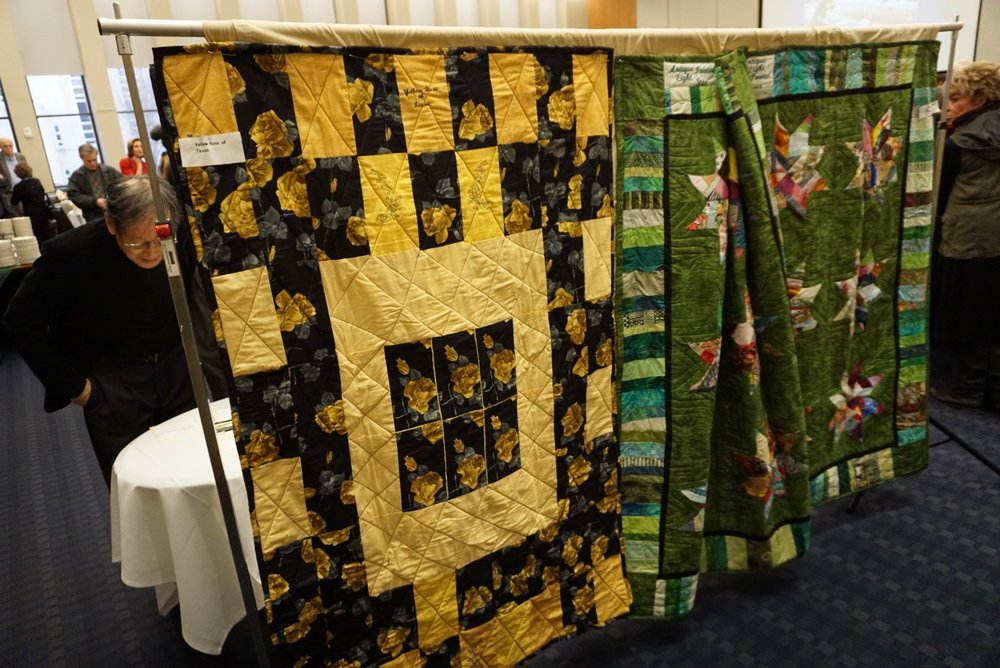 The event was punctuated by the live and silent raffle of several of Charlotte's sublime quilts and Brad Heckman's signed prints from our most recent exhibit.
