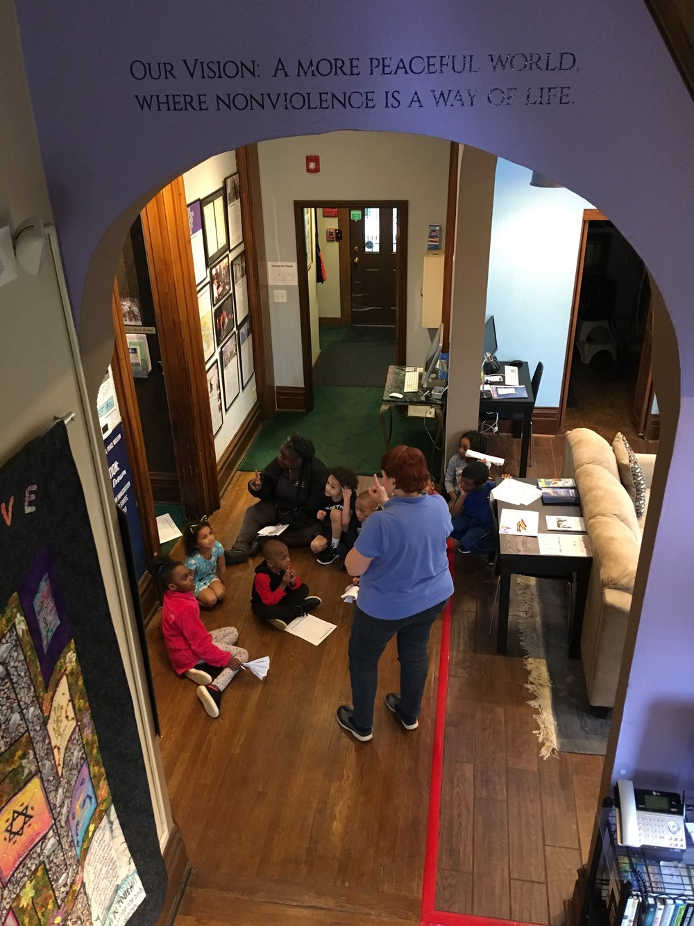 Giving tours to school groups often requires volunteer museum guides to come in early, but the Museum is committed to young people and promoting nonviolence and the merits of building peace and friendships in our community.
