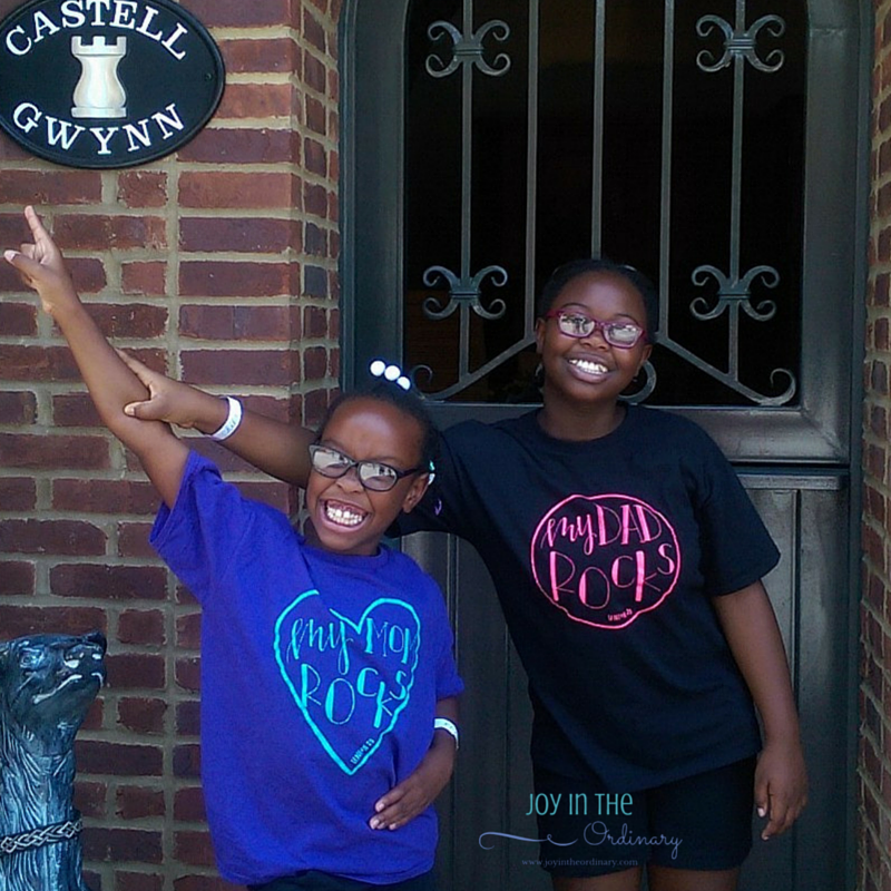 "The girls sporting their "" My Mom Rocks"" and ""My Dad Rocks"" shirts."