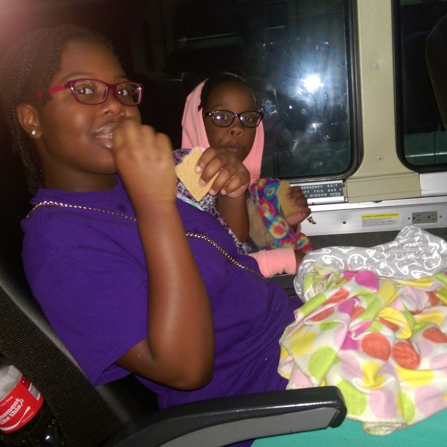 The girls munching on snacks as we head west on the midnight bus.