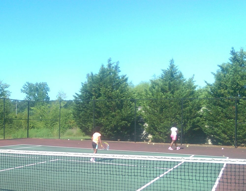 We take advantage of the tennis courts in our complex during the day.