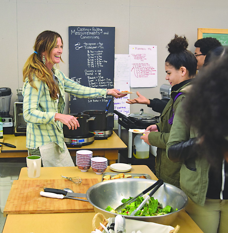 "Karen Henderson, the executive director at Edible Sac High, and a few of her students. ""Eating Lessons"" in  January 2018 Inside East Sacramento ."