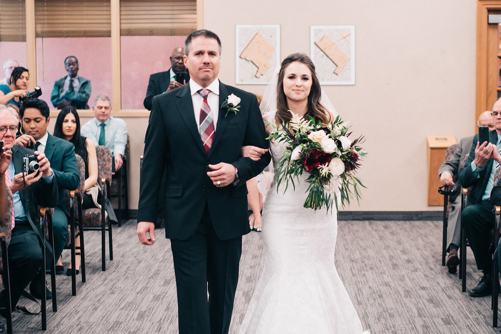 Amber-Lee and her dad walking up the aisle