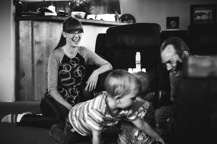 mom laughing while kids play