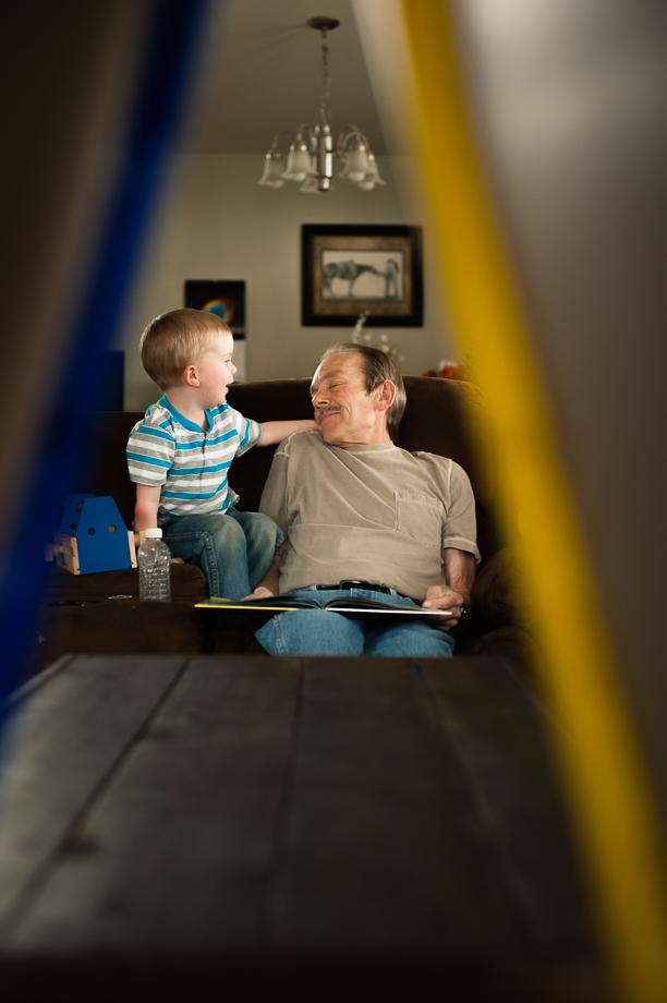 boy tickling grandpa