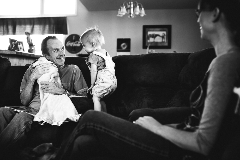 grandpa and girl playing baby