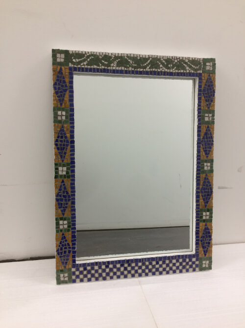 Mosaic mirror with pattern from the NYC subway for a Manhattan bathroom - ceramic