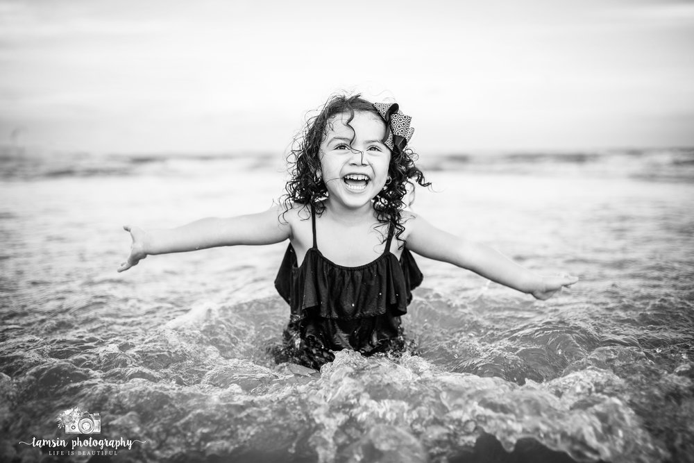Black and white photography kids childhood florida beach.jpg