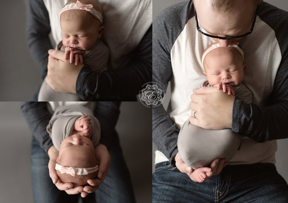 baby-girl-in-fathers-hands.jpg