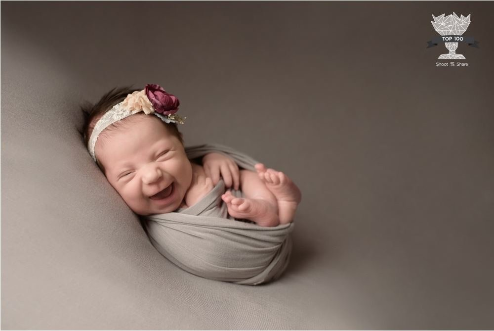 "This baby girl placed 48th out of 5,181 photographs in the ""Share Joy"" category."