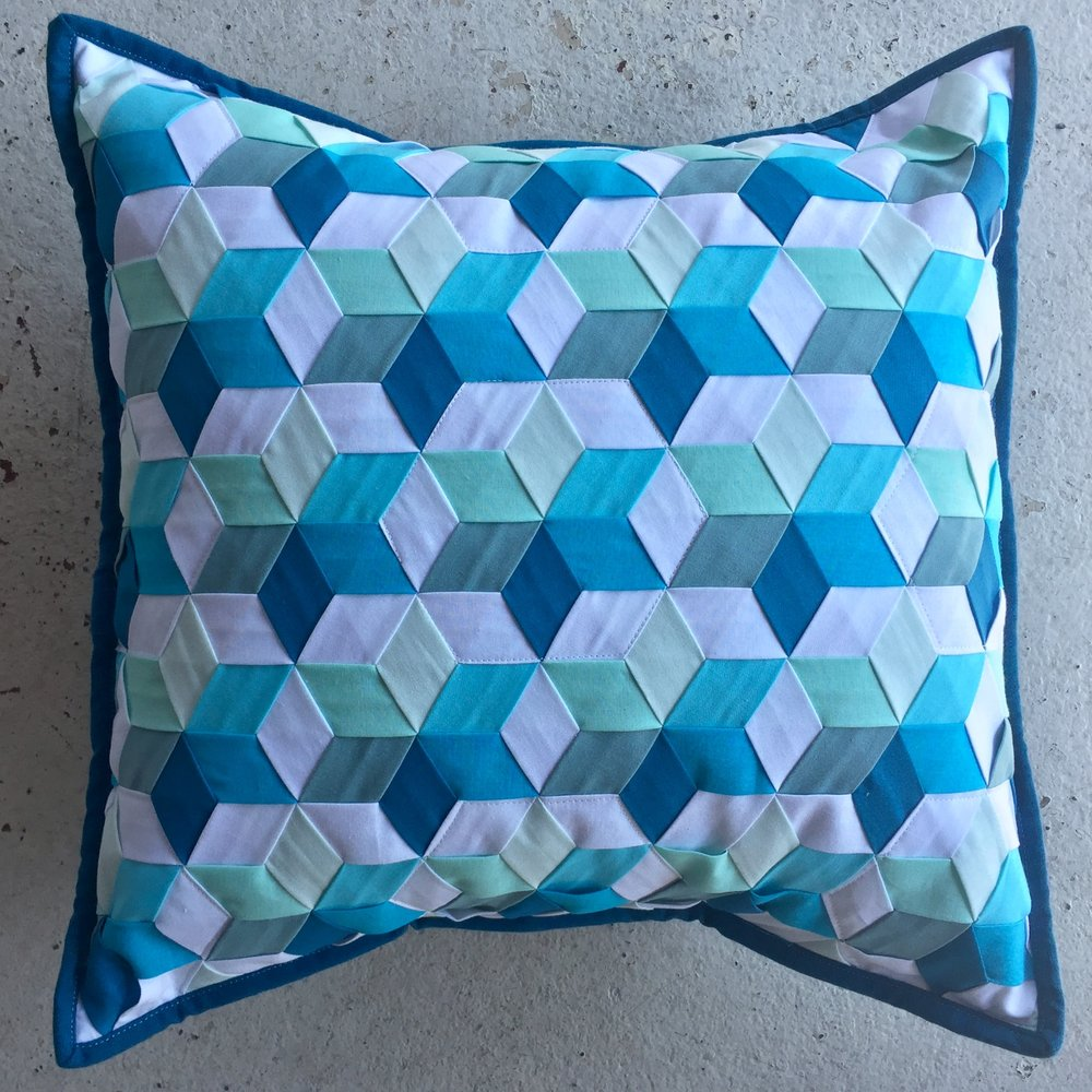 "The Woven Star Variations Cushion Cover measures 16"" square."