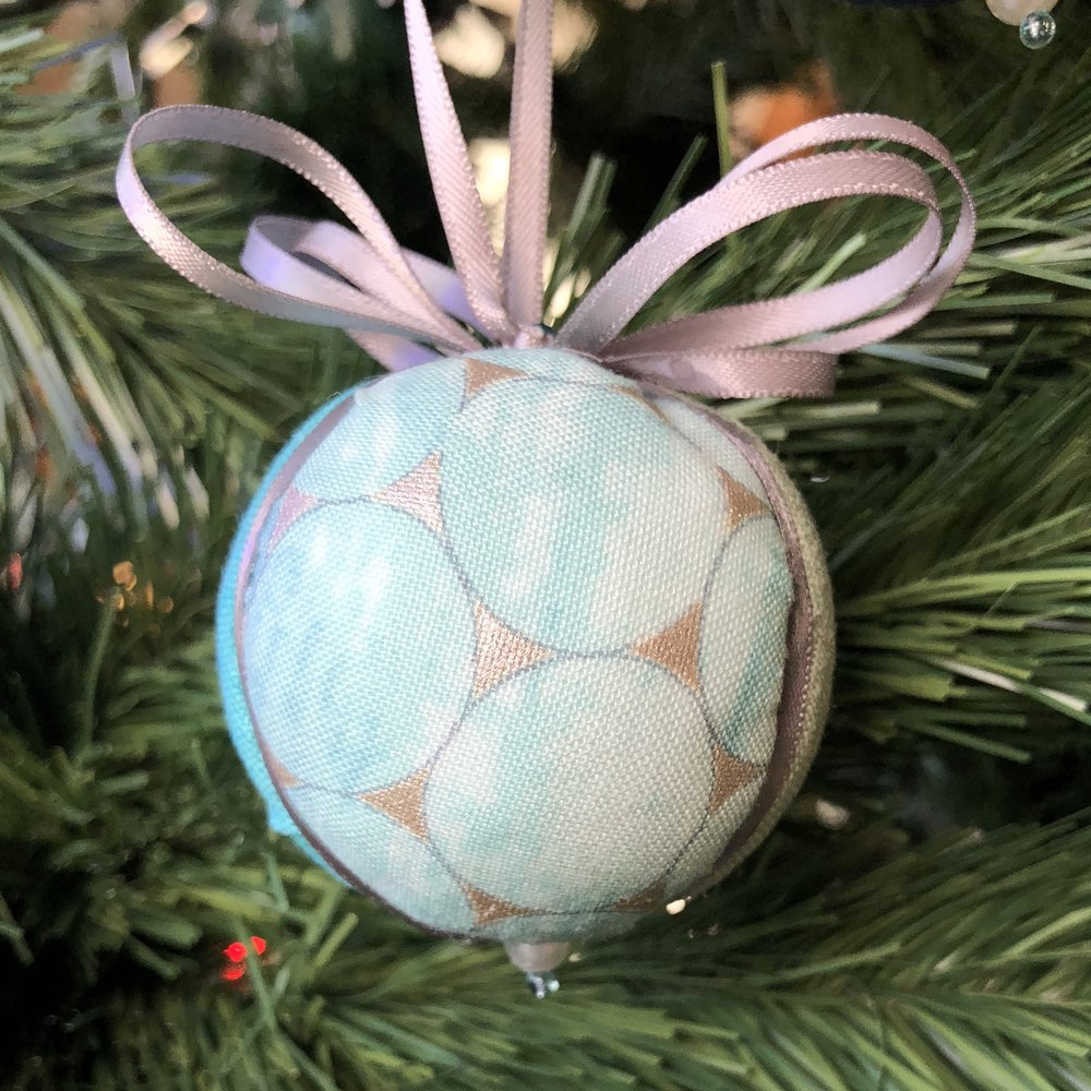 Kimekomi Ball divided into three wedges, with ribbon covering the seams.
