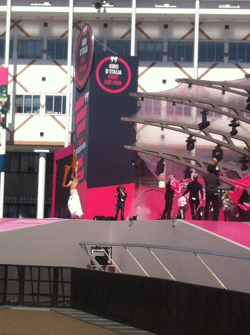 Eurovision meets the Giro with a half naked performer wrapped in a white sheet twirling a gold baton