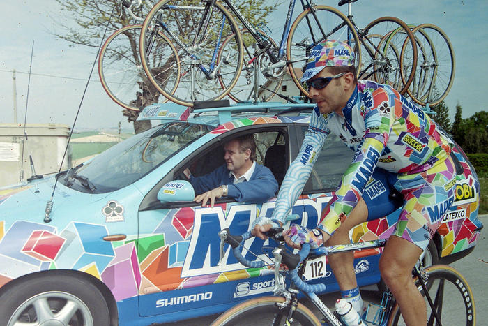 The late great Franco Ballerini alongside the Mapei team car