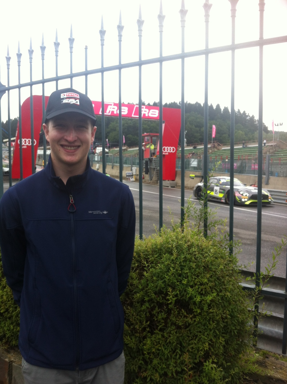 Conor at Spa Francochamps Motor Racing Circuit in the main Paddock as Le Mans style cars leave the pits for Eau Rouge & Kemmel Straight.