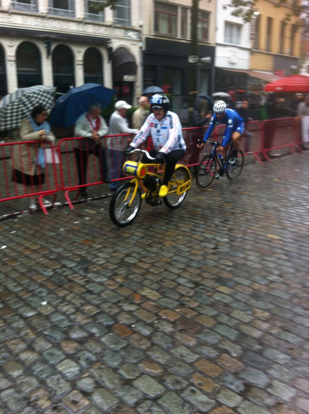 Tom Boonen approaches the greasy left hand corner in never ending Antwerp rain