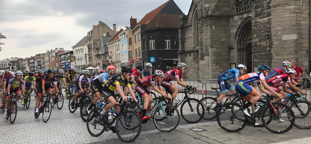 Deinze 17 - The only time for Peter Livingstone (red jersey black helmet) to pass the Deinze Church as a puncture after just 4k ended the day before it even started.