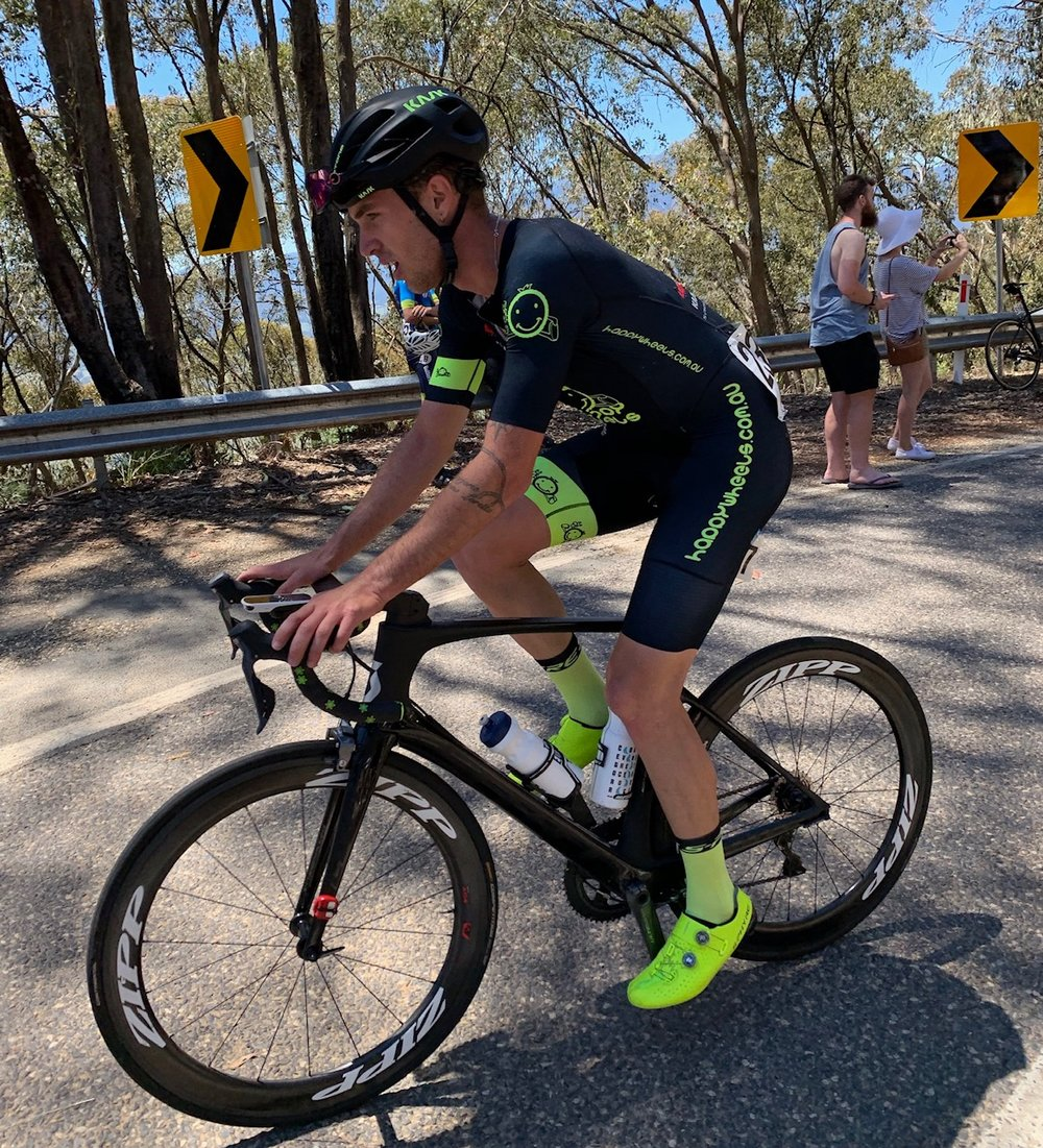 Tour of Bright 18 @ 1 Dec - Declan Jones near the summit of the Tawonga Gap climb