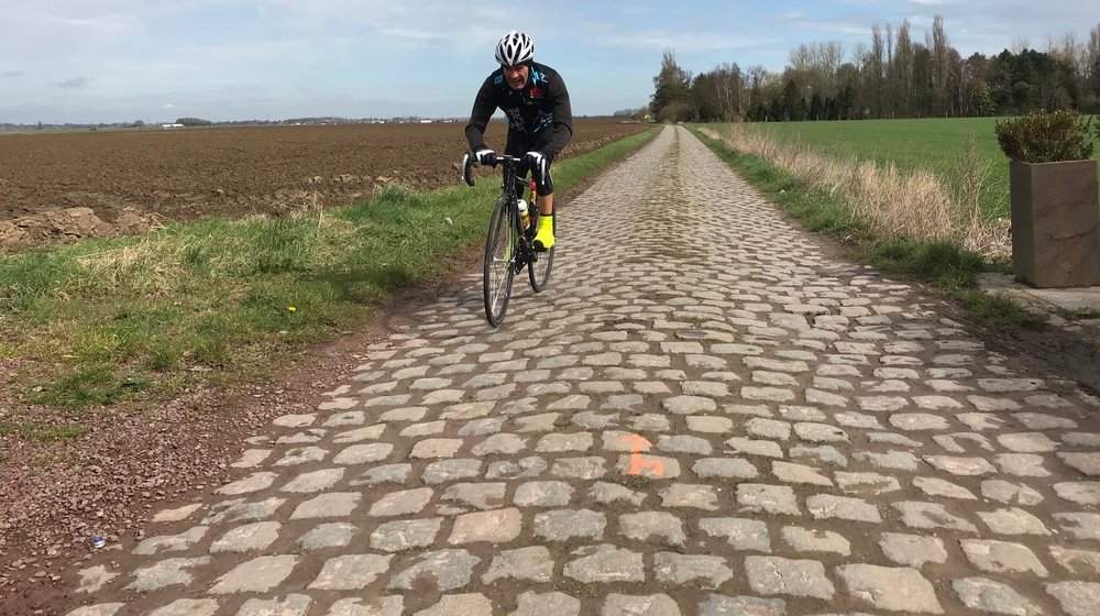 Italy-Belgium 2019 - Mike Lawson (BiciSport Master) pictured on the Carrefour De L'Arbre cobbles outside Roubaix in April 2018.    Mike returns to the Holy Land of cycling for the Strade Bianche Cyclosportive in Seina (Italy) on 10 March, followed by three weeks in Belgium with cyclosportives in Wevelgem, Flanders & Roubaix and a raft of Belgian Spring Classics.