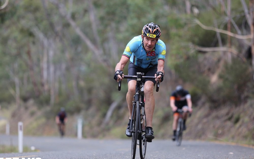 3 Peaks Challenge @ Falls Creek @ 10 Mar - Mike Taylor climbing through WTF Corner outside Omeo on the way back to Falls Creek