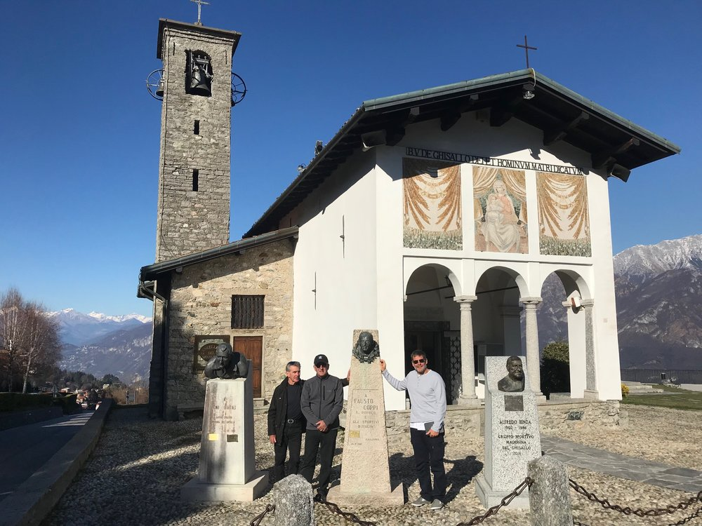 Madonna de Ghisallo Church @ 20 Mar  - situated at the top of the Ghisallo climb above Lake Como at the Fausto Coppi monument (L to R) - Mike Lawson, Mike O'Reilly & Marty Wright