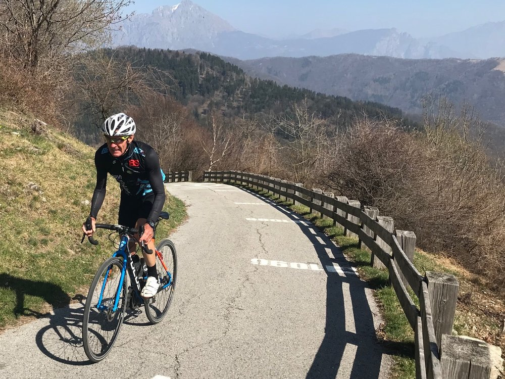 Muro Di Sormano @ 24 March  - Mike Lawson at the top of the Muro di Sormano (Wall of Sormano). This one lane cycle path (no cars permitted) is used in the Tour of Lombardy one day pro Classic in October each year. The average gradient is 17%, with the maximum topping out at a leg snapping 25%.