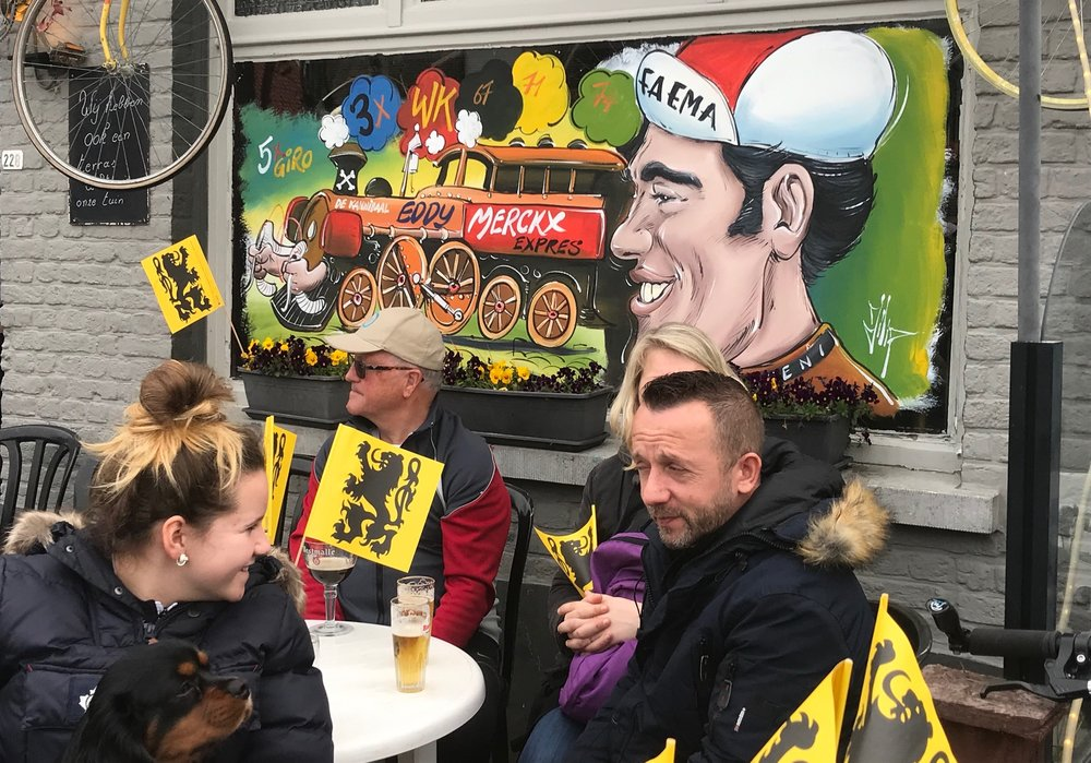 RVV @ 7 April -  Eddy Merckx hasn't retired and lives on at the Koppenberg Cafe. Flanders flags are everywhere.